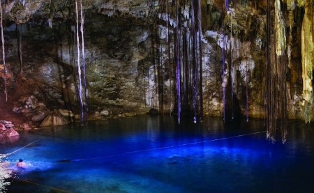 Swimming-snorkeling-and-diving-in-the-blue-of-the-cenote-in-the-Yucatan-peninsula-Mexico